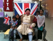 Henry VIII greet some local children
