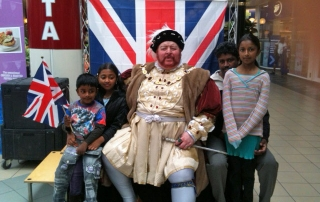 Henry VIII greet some local children