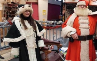 Alan Myatt dressed as Father Christmas, giving our presents to children